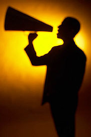 Silhouette of man yelling into a bullhorn uid 1272227