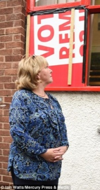 councillor-bernie-mooney-in-front-of-stairwell-window